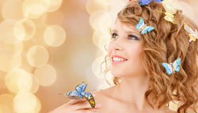 Happy teenage girl with butterflies in hair Stock Photo
