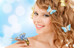 Happy teenage girl with butterflies in hair Royalty Free Stock Images