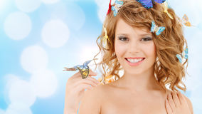Happy teenage girl with butterflies in hair Stock Photos