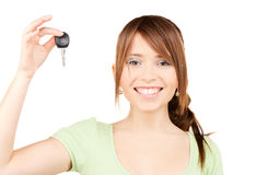 Happy teenage girl with car key Stock Photos