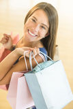 Happy Teenage Girl Carrying Shopping Bags Royalty Free Stock Photo
