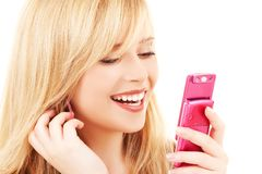 Happy teenage girl with cell phone Royalty Free Stock Photos