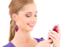Happy teenage girl with cell phone Royalty Free Stock Image