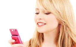 Happy teenage girl with cell phone Royalty Free Stock Images