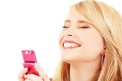 Happy teenage girl with cell phone Stock Images