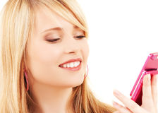 Happy teenage girl with cell phone Royalty Free Stock Photography