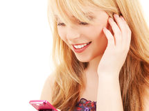 Happy teenage girl with cell phone Stock Image