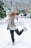 Happy teenage girl dancing in the snow Royalty Free Stock Photo