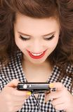 Happy teenage girl with digital camera Royalty Free Stock Photography