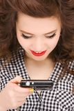 Happy teenage girl with digital camera Stock Images