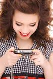 Happy teenage girl with digital camera Royalty Free Stock Image
