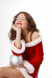 Happy teenage girl dreaming with christmas ball Stock Photos
