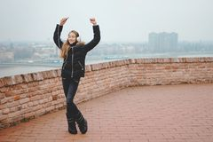 Happy teenage girl enjoys listening to the music and dancing royalty free stock photo