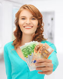 Happy teenage girl with euro cash money Stock Photo