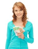 Happy teenage girl with euro cash money Royalty Free Stock Images