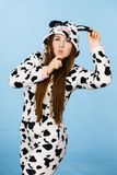Woman wearing pajamas cartoon making silly face. Happy teenage girl in funny nightclothes, pajamas cartoon style making silly face, positive face expression Stock Images