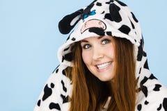 Woman wearing pajamas cartoon smiling. Happy teenage girl in funny nightclothes, pajamas cartoon style smiling, positive face expression, studio shot on blue Stock Image