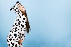 Woman wearing pajamas cartoon smiling. Happy teenage girl in funny nightclothes, pajamas cartoon style smiling, positive face expression, studio shot on blue Royalty Free Stock Image