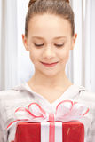 Happy teenage girl with gift box Stock Photos