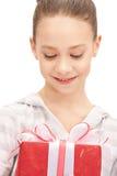 Happy teenage girl with gift box Stock Photography