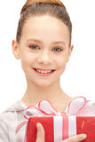 Happy teenage girl with gift box Stock Image