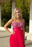 Happy Teenage Girl Going to the Prom in a Red Dress Royalty Free Stock Photo