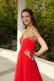 Happy Teenage Girl Going to the Prom in a Red Dress Royalty Free Stock Photos