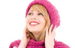 Happy teenage girl in hat. Happy teenage girl in winter hat over white Stock Images