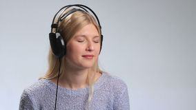 Happy teenage girl in headphones over white stock video