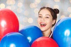Happy teenage girl with helium balloons Stock Photography