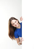 A happy teenage girl holding a large white banner Stock Photography