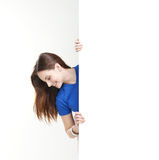 A happy teenage girl holding a large white banner Stock Images