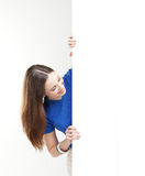 A happy teenage girl holding a large white banner Stock Photos