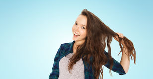Happy teenage girl holding strand of her hair Royalty Free Stock Photos