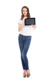 A happy teenage girl holding a tablet Royalty Free Stock Photos
