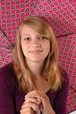 Happy teenage girl holding umbrella studio Stock Photography