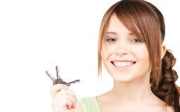 Happy teenage girl with keys Royalty Free Stock Photos