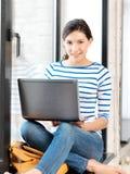 Happy teenage girl with laptop computer Stock Photo