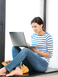 Happy teenage girl with laptop computer Stock Photography