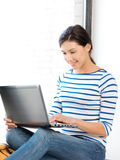 Happy teenage girl with laptop computer Stock Photos