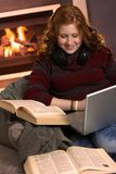 Happy teenage girl learning at home with books Stock Photography