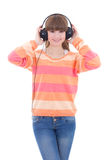 Happy teenage girl listening music in headphones isolated on whi Stock Photo