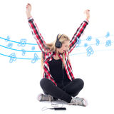 Happy teenage girl listening music in headphones over white Royalty Free Stock Image