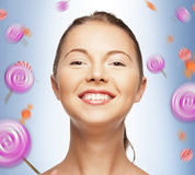 Happy teenage girl with lollipops Royalty Free Stock Photography