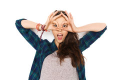 Happy teenage girl making face and having fun. People and teens concept - happy smiling pretty teenage girl making face and having fun royalty free stock photo