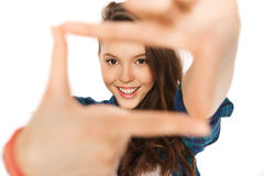 Happy teenage girl making frame of fingers Royalty Free Stock Photos