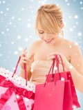 Happy teenage girl with many shopping bags Stock Image