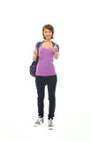 A happy teenage girl in modern clothes holding thumbs up Stock Image