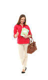 A happy teenage girl in modern clothes holding thumbs up Royalty Free Stock Images