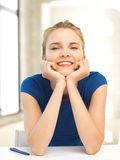 Happy teenage girl with pen and paper Royalty Free Stock Images